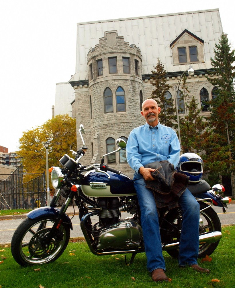 Mr. McMahon with his motorcycle in front of Lisgar